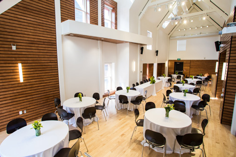 Johnson hall setup with round tables and chairs