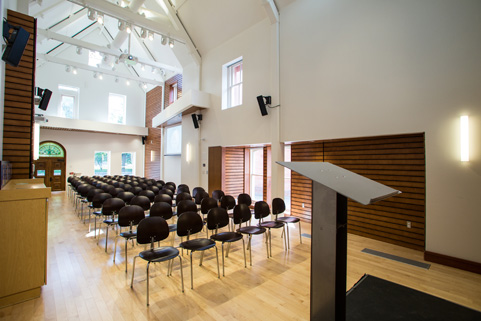 Johnson hall setup theatre style with chairs and a stage
