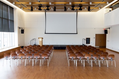 conference room setup with chairs, scene and podium